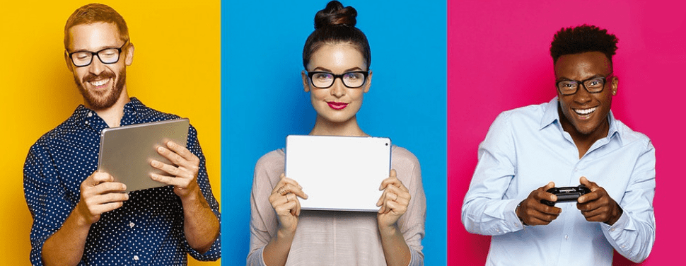 3 smiling people with eyezen glasses using electronics